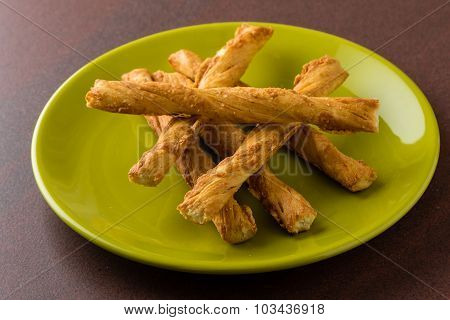Pastry Sticks With Cheese On Green Plate
