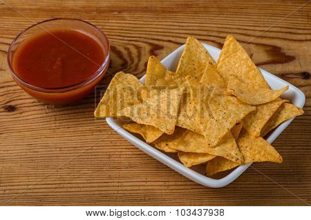 Tortilla Chips With Dip On A Wooden Table