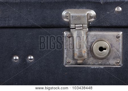 Lock of an old black suitcase