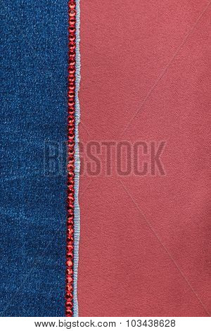 Fashionable background,  jeans and red rhinestones lying on red satin
