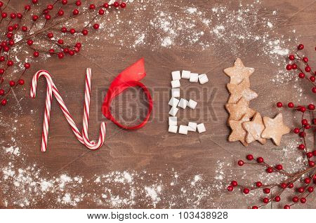 Christmas decorations and food on the wooden background