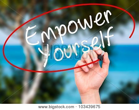 Man Hand writing Empower Yourself with black marker on visual screen
