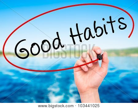 Man Hand writing Good Habits with black marker on visual screen.