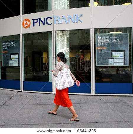 CHICAGO - FRIDAY, SEPTEMBER 25, 2015: Pedestrians walk past a PNC Bank in Chicago. PNC Financial Services Group, Inc. is an American financial services corporation
