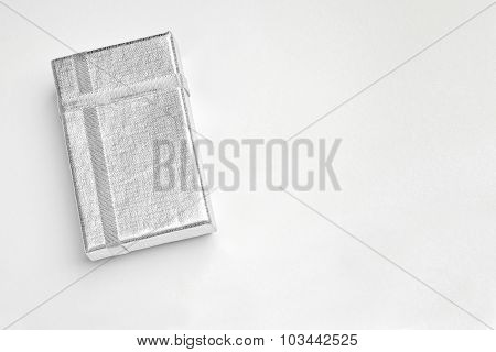 Small Flat Silver Box With Silver Ribbons Top