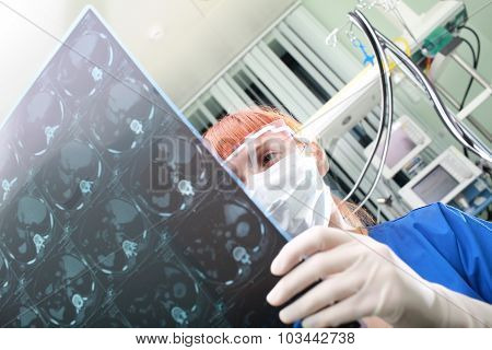 Red hair doctor exams the patient's X-ray