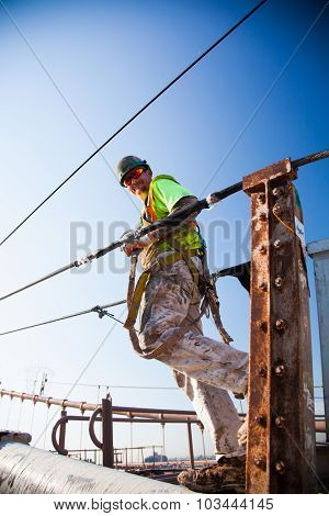 NEW YORK CITY, USA - CIRCA SEPTEMBER 2014: Manual worker climbing the Brooklyn Bridge in New York City