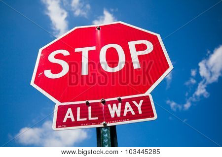 NEW YORK CITY, USA - CIRCA SEPTEMBER 2014: Stop sign in front of bright blue sky