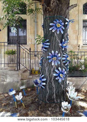 Tree Decorated With Plastic Flowers