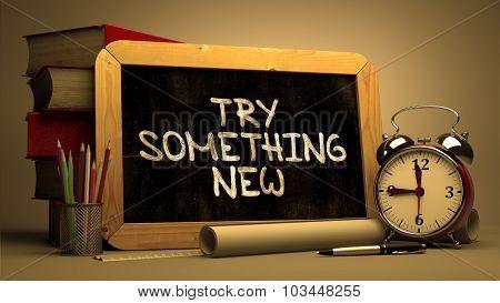 Try Something New Handwritten on Chalkboard.