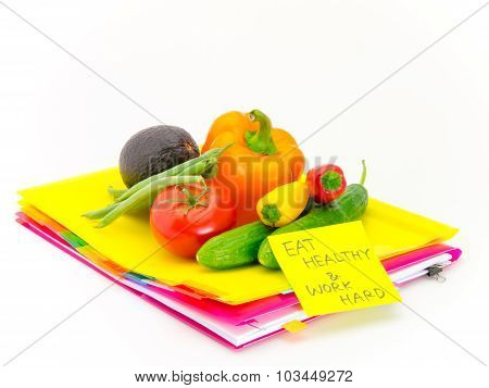 Office Documents And Vegetables; Eat Healthy And Work Hard