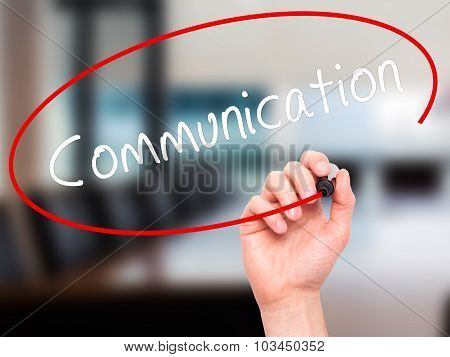 Man Hand writing Communication with black marker on visual screen.