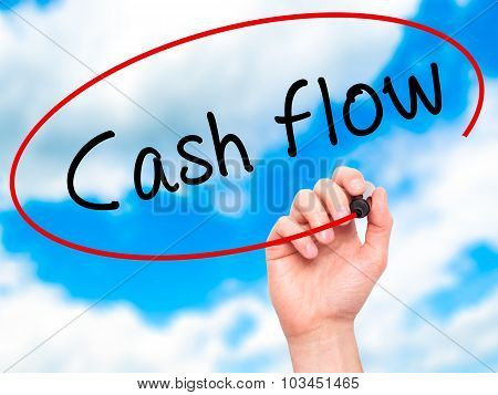 Man Hand writing Cash flow with black marker on visual screen