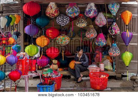 HOI AN VIETNAM, DECEMBER 14, 2014 : A man is selling colorful hand crafted paper lantern in the streets of Hoi An, Vietnam