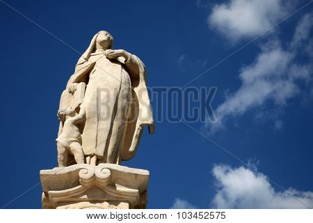 BJELOVAR, CROATIA - SEPTEMBER 06: Saint Teresa of Avila statue in front of the Cathedral of St. Teresa of Avila in Bjelovar, Croatia on September 06, 2013