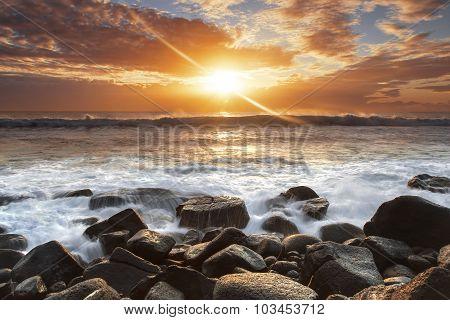 Sunrise over the ocean, on the rocks at Burleigh Heads