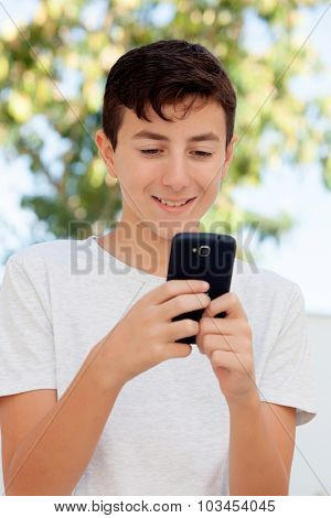 Funny teenage boy looking at the mobile