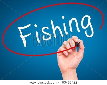 Man Hand writing Fishing with black marker on visual screen.
