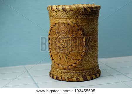 Salt shaker from birch bark against a blue background