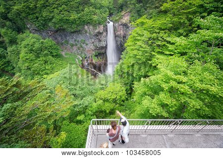 Blurred tourists visiting Kegon Falls, Nikko, wide angle
