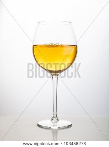 Glass of wine on a white background.
