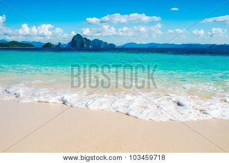 Blue Sea Wave On White Sand Beach