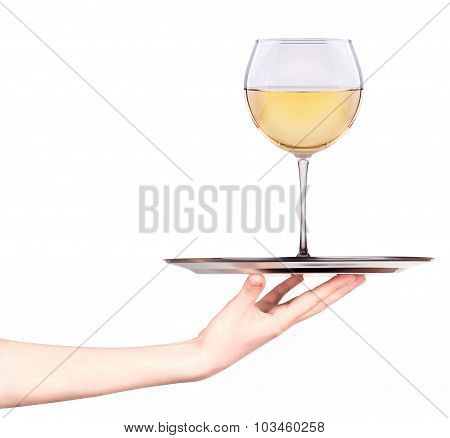 Waitresses holding tray with glass of white wine