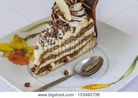 Tiramisu Cake And Spoon On A Saucer Closeup