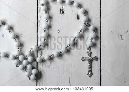 Rosary On Rustic Wooden Surface