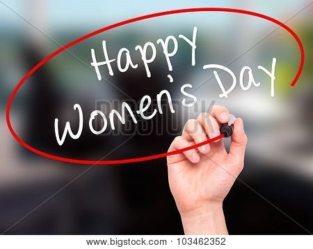 Man Hand writing Happy Women's Day with black marker on visual screen.