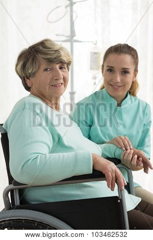 Smiling Disabled Woman And Nurse