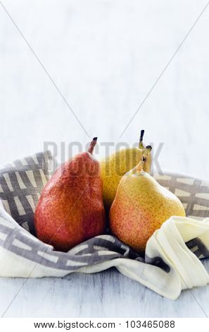 Fresh pears on a wooden texture