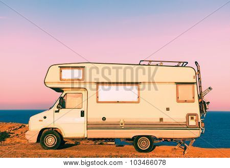 Camper On The Seashore At Sunset
