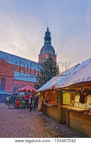 Christmas Market In Old Riga At Dusk