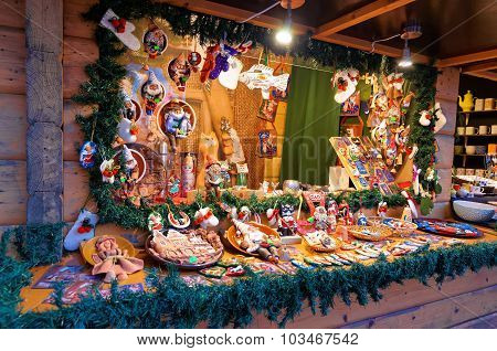 Christmas Market Stall With The Huge Variety Of Souvenirs In Riga