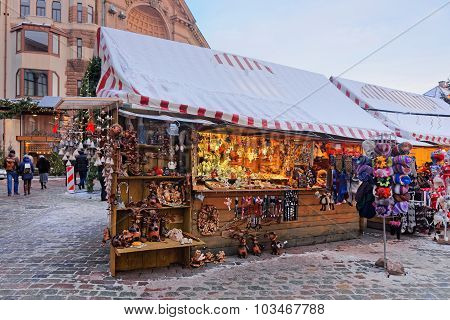 Christmas Market Stall With Traditional Souvenirs For Sale