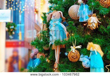 Fragment Of The Christmas Tree Decorated With Gifts And Ornaments
