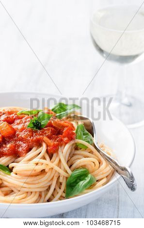 Healthy delicious vegetarian pasta dish with tomato sauce and basil leaves, traditional italian meal and mediterranean cuisine