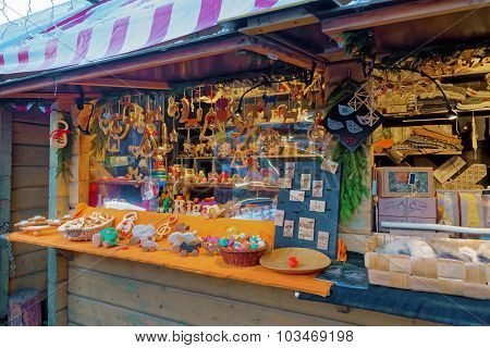 Trraditional Christmas Market Stall Full Of Natural Wooden Souvenirs