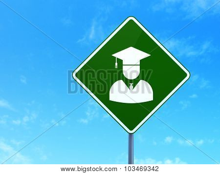 Education concept: Student on road sign background
