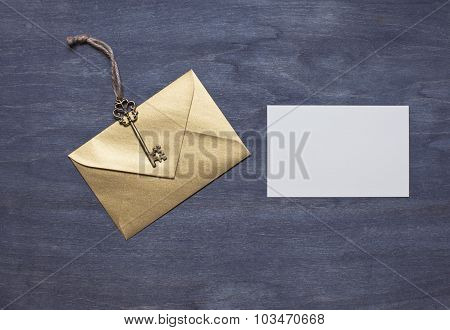 Gold Envelope With Key And Invitation Card