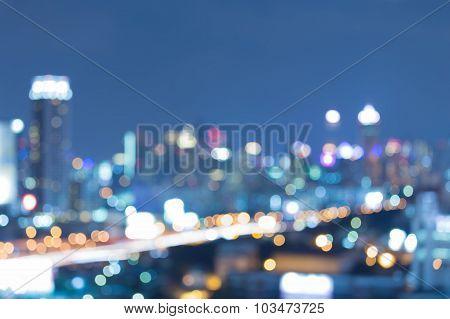 Abstract blurred bokeh city downtown with road during twilight