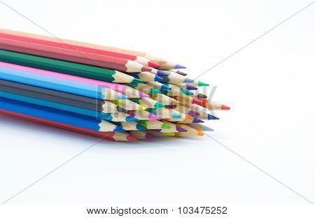 Vintage tone of multiple colour wooden pencils on white background