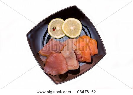 Trio of smoked fish on plate from above