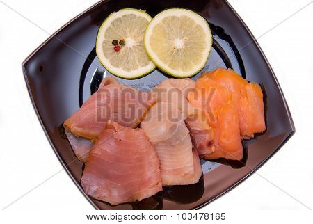 Trio of smoked fish on plate from above and close