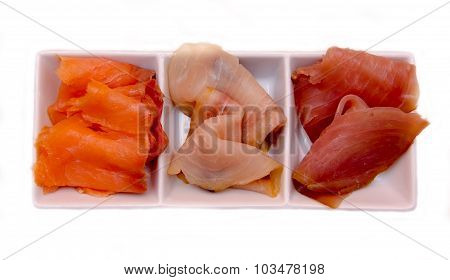 Trio of smoked fish platter on top