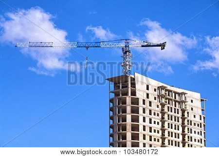Tower Crane On Top Of The Construction Site