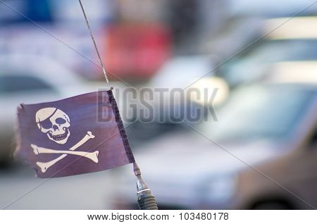 Pirate Flag On The Car Antenna