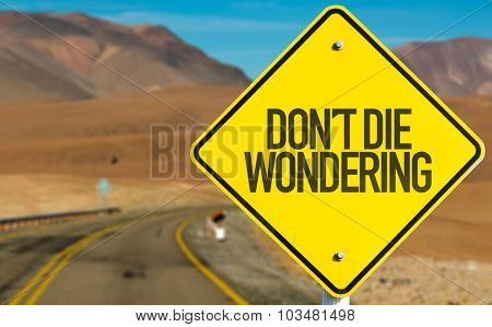 Don't Die Wondering sign on desert road