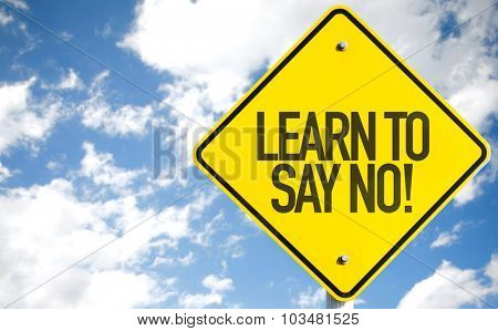 Learn To Say No! sign with sky background